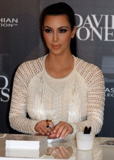 Kim Kardashian signs her autograph during the launch of her fashion accessory range at a department store in Sydney, Australia, Thursday, Nov. 3, 2011. (AP / Rob Griffith)