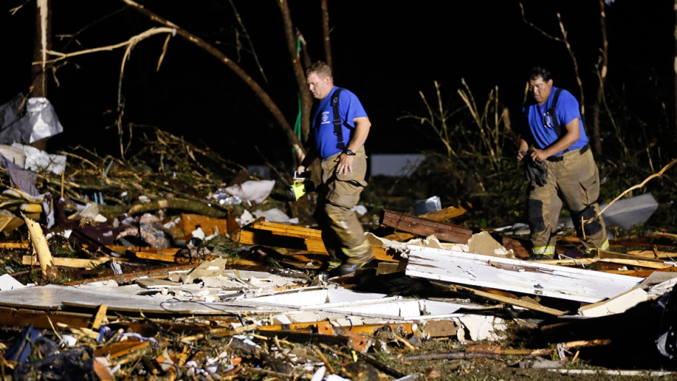 Emergency personnel search the remains of several mobile homes for survivors in Louisville, Miss., early Tuesday morning, April 29, 2014. (AP / Rogelio V. Solis)