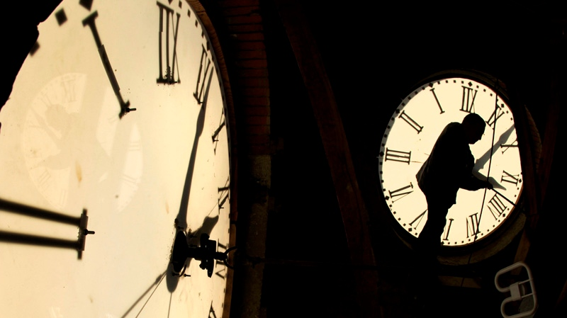 Custodian Ray Keen checks the time on a clock face after changing the time on the 97-year-old clock atop the Clay County Courthouse in Clay Center, Kan., Nov. 6, 2010. (AP / Charlie Riedel)