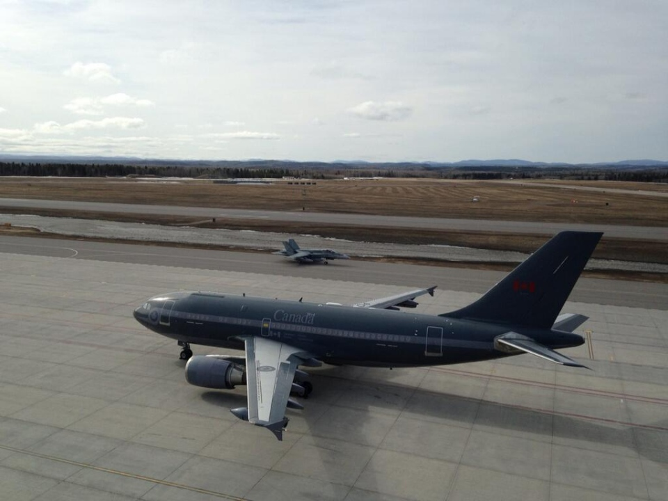 RCAF air-to-air refuelling tanker CC-150T, forefront, sits on the runway beside a CF-18 at CFB Bagotville in Quebec, Tuesday, April 29, 2014. (Max Harrold / CTV News Montreal)