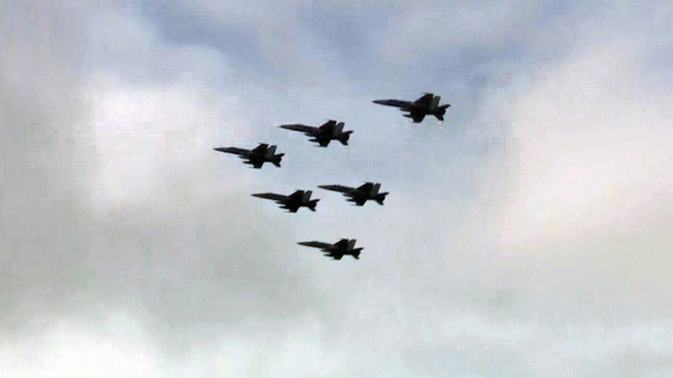 Six CF-18 fighter jets take off from CFB Bagotville in Quebec, Tuesday, April 29, 2014.