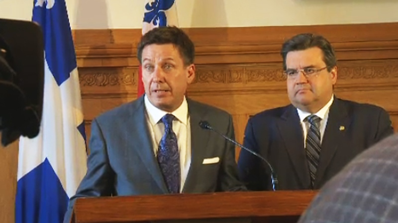 Municipal Affairs Minister Pierre Moreau and Mayor Denis Coderre vowed to work together to help Montreal at a press conference at City Hall Tuesday morning. (CTV Montreal April 29, 2014)