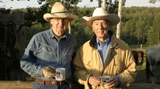 Lloyd Robertson and Craig Oliver share a smile enjoying the outdoors in this undated photo.