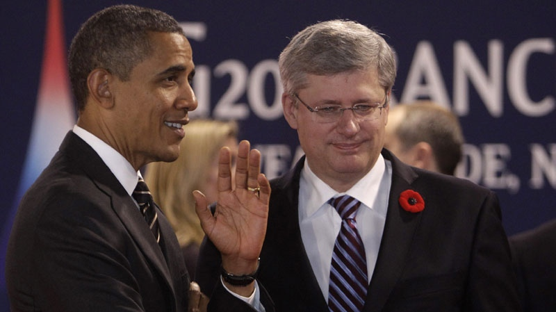 U.S. President Barack Obama speaks with Prime Minister Stephen Harper on Nov. 4, 2011