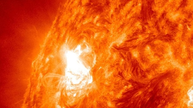 "This image provided by NASA shows giant sun spot activity Thursday, Nov. 3, 2011, from a region on the sun that scientists are calling a ""benevolent monster."" After years of quiet, the sun is coming alive with solar storms in a big way."