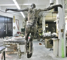 'My Sweet Lord,' a chocolate statue by artist Cosimo Cavallaro of a naked Jesus hangs at Ranieris Sculpture Casting studio in New York. (AP / Mary Altaffer)