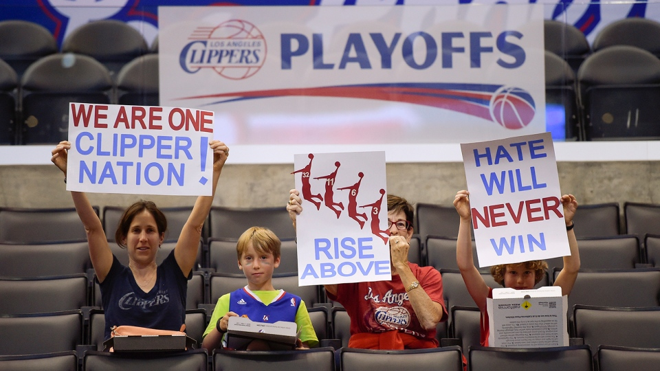 Fans hold up signs in support of the Los Angeles Clippers before Game 5 of an opening-round NBA basketball playoff series between the Clippers and the Golden State Warriors in Los Angeles, Tuesday, April 29, 2014, in Los Angeles. (AP Photo)