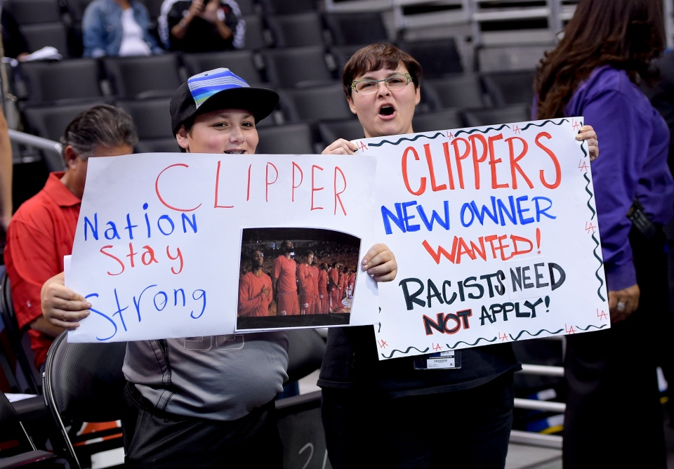 Fans hold up signs in support of the Los Angeles Clippers before Game 5 of an opening-round NBA basketball playoff series between the Clippers and the Golden State Warriors in Los Angeles, Tuesday, April 29, 2014.  (AP)