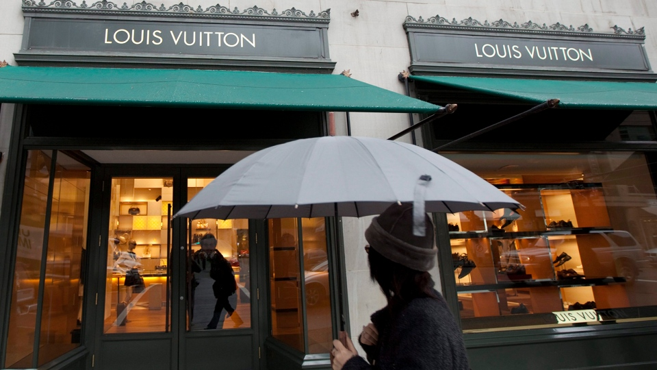 A pedestrian walks past a Louis Vuitton store in downtown Vancouver, B.C. Tuesday, March 8, 2011. (Jonathan Hayward / THE CANADIAN PRESS)