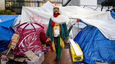 A protester dressed in a costume emerges from a tent at the Occupy Vancouver site in downtown Vancouver, B.C., on Friday, November 4, 2011. Fire officials ordered the removal of unoccupied tents and overhead tarps at the site, citing safety concerns. (CP/Darryl Dyck)