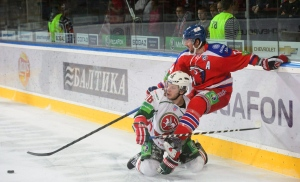 Mikhail Varnakov of AK BARS Kazan, left, and Nathan Oystrick of HC Lev Praha, right, fight for the puck during their Kontinental Hockey League (KHL) ice hockey match in Prague, Czech Republic, Monday, Sept. 23, 2013. (AP Photo/CTK, Michal Kamaryt)