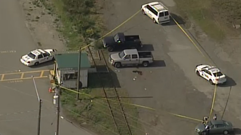 A large area outside a Nanaimo, B.C., sawmill is taped off following a shooting on April 30, 2014. (CTV)