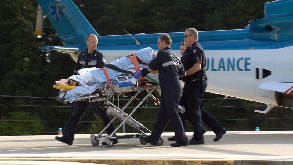 A person is transported to Victoria General Hospital following a shooting at a sawmill in Nanaimo, B.C., Wednesday, April 30, 2014.