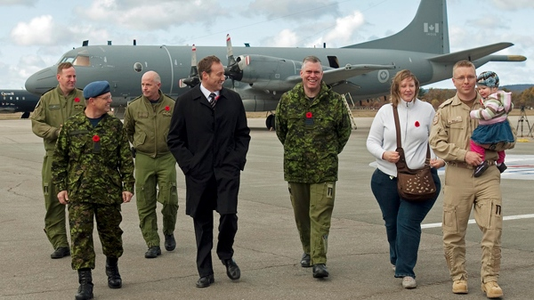 Col. Jim Irvine, left base commander at CFB Greenwood, right, and Defence Minister Peter MacKay greet air crew as they return from Operation Mobile, Canada's military contribution to the crisis in Libya, in Greenwood, N.S. on Saturday, Nov. 5, 2011. (Andrew Vaughan / THE CANADIAN PRESS)