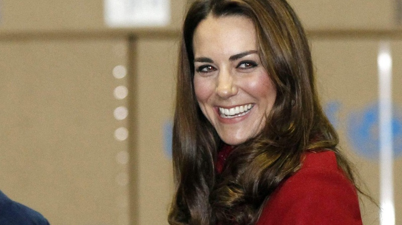 Britain's catherine Duchess of Cambridge smiles when she visited the UNICEF Supply Division Centre, Copenhagen Wednesday Nov. 2, 2011. (AP Photo/Phil Noble/PA)