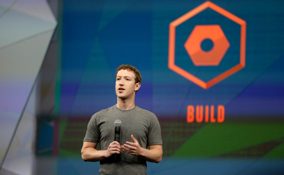 Facebook CEO Mark Zuckerberg gestures while delivering the keynote address at the f8 Facebook Developer Conference Wednesday, April 30, 2014, in San Francisco. (AP / Ben Margot)