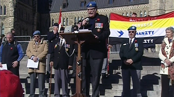 Canadian Veterans Advocacy president Michael Blais speaks at a rally protesting the cuts to Veterans Affairs on Parliament Hill in Ottawa on Saturday, Nov. 5, 2011.