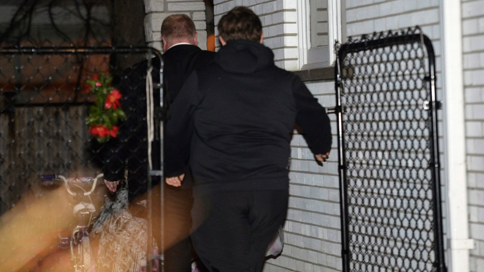 Toronto mayor Rob Ford, left, arrives at his home in Toronto early Thursday May 1, 2014.  (Nathan Denette / THE CANADIAN PRESS)