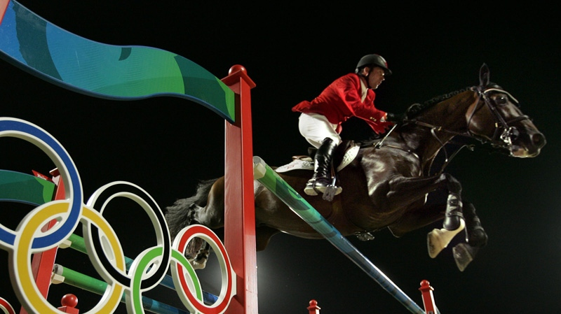 A Thursday, Aug. 21, 2008 photo from files showing Eric Lamaze of Canada as he rides Hickstead during the Equestrian Individual Jumping competition at the Beijing 2008 Olympics in Hong Kong. (AP Photo/Susan Walsh, File)
