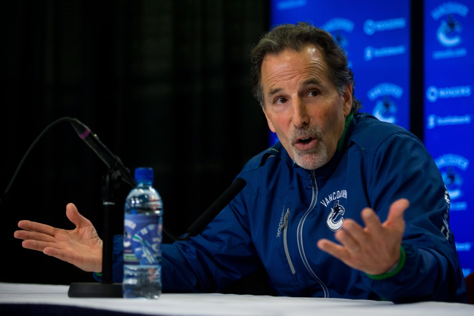 Vancouver Canucks' head coach John Tortorella gestures while responding to questions during an end of season news conference in Vancouver, B.C., on Monday April 14, 2014. (Darryl Dyck / THE CANADIAN PRESS)