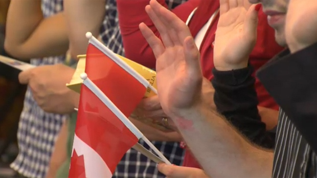 New Canadians take part in a swearing-in ceremony in Calgary