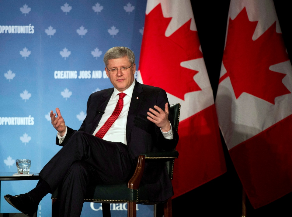 Prime Minister Stephen Harper participates in a question and answer session with the Greater Kitchener Waterloo and the Cambridge Chambers of Commerce in Kitchener, Ont., on Friday, April 25, 2014. (Nathan Denette / THE CANADIAN PRESS)