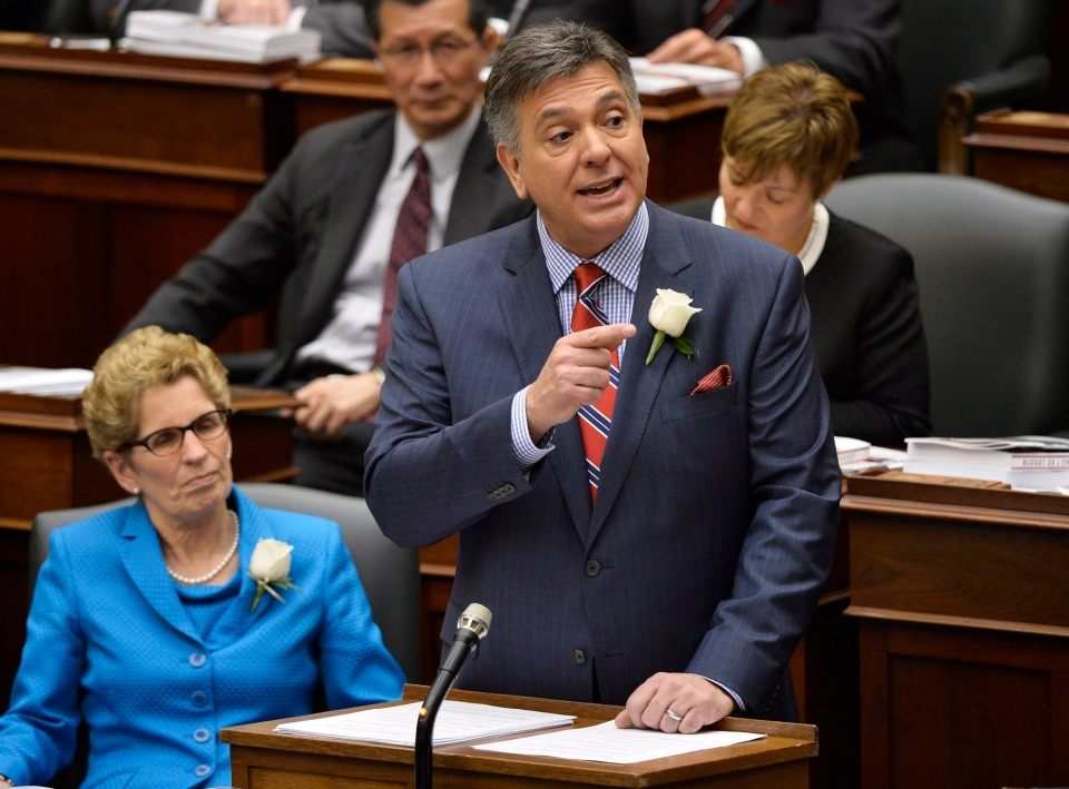 Ontario Finance Minister Charles Sousa, right, delivers the 2014 budget next to Premier Kathleen Wynne at Queen's Park in Toronto on Thursday, May 1, 2014. (Nathan Denette / THE CANADIAN PRESS)