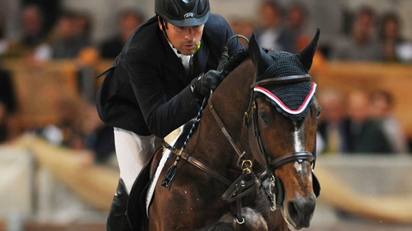 In this image released by the Fiercavalli press office, Olympic show jumping champion Eric Lamaze and his horse Hickstead are seen in action during a World Cup event in Verona, Italy, Sunday, Nov. 6, 2011. (AP Photo/Bruno De Lorenzo, Fiercavalli Press Office)