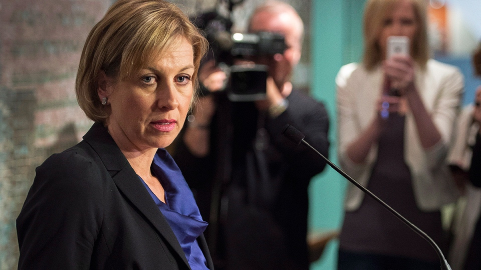 Mayoral candidate Karen Stintz reads from a prepared statement regarding the latest Rob Ford allegations during a press conference at City Hall in Toronto on Thursday, May 1, 2014. (Darren Calabrese / THE CANADIAN PRESS)