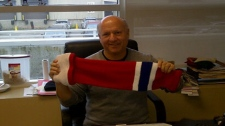 """David Tock of Do-Gree shows off the latest innovation in cut-resistant hockey protection: """"The Gladiator"""" sock/stocking (Courtesy: Eric Engels)"""