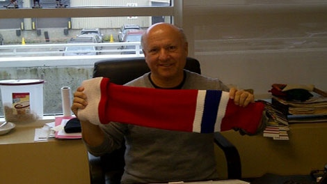 "David Tock of Do-Gree shows off the latest innovation in cut-resistant hockey protection: ""The Gladiator"" sock/stocking (Courtesy: Eric Engels)"