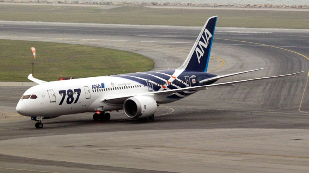 An All Nippon Airways Boeing 787 lands at Hong Kong International Airport for the airplane's inaugural commercial flight from Japan, on Wednesday, Oct. 26, 2011. (AP / Kin Cheung)