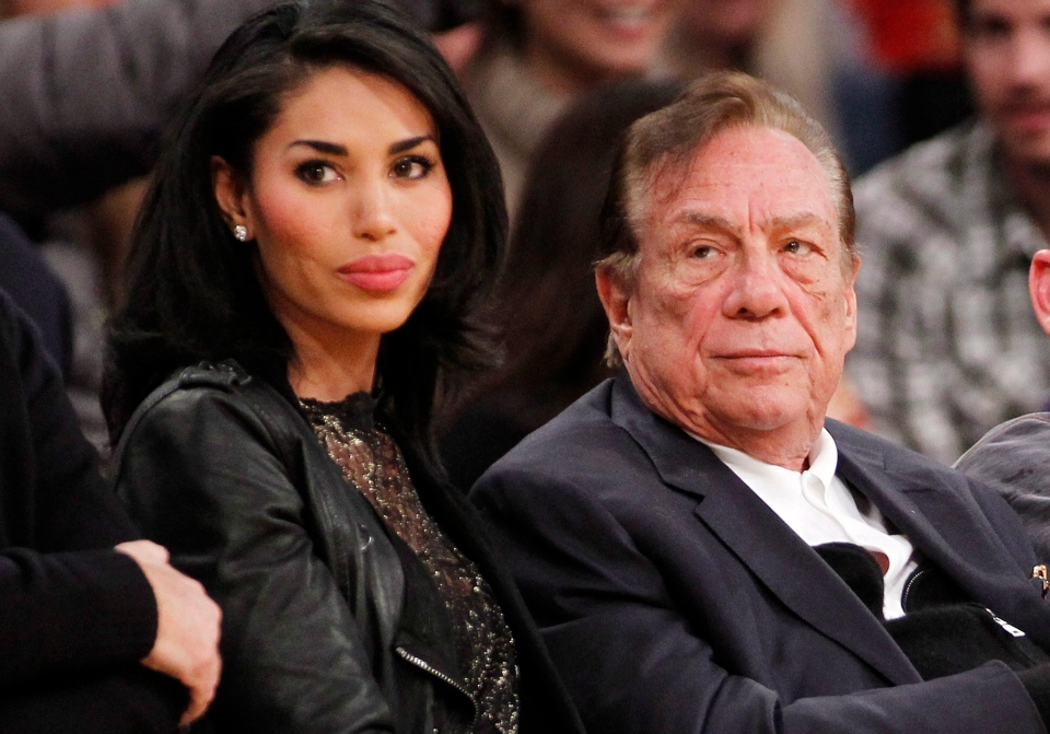 Los Angeles Clippers owner Donald Sterling, right, and V. Stiviano, left, watch the Clippers play the Los Angeles Lakers during an NBA preseason basketball game in Los Angeles on Dec. 19, 2010. (AP / Danny Moloshok)