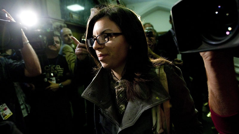 NDP MP Niki Ashton is seen walking past reporters on her way to a special caucus meeting on Sept. 23, 2010