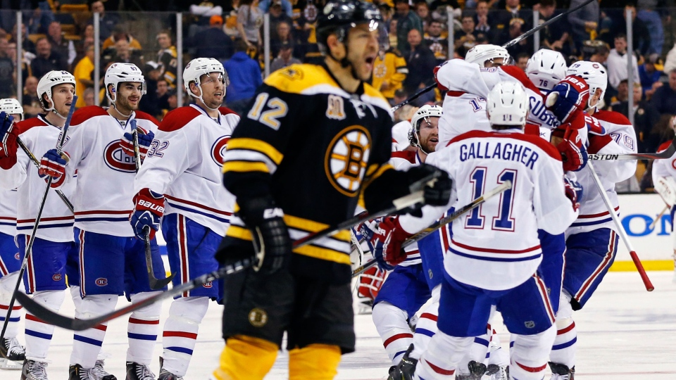 Montreal Canadiens teammates jump on P.K. Subban, right, after his game-winning goal in the second overtime period as Boston Bruins right wing Jarome Iginla (12) skates away in Game 1 of an NHL hockey second-round playoff series in Boston, Thursday, May 1, 2014. (AP / Elise Amendola)