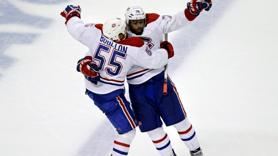 Montreal Canadiens defenseman Francis Bouillon (55) leaps into the arms of teammate P.K. Subban (76) after scoring on Boston Bruins goalie Tuukka Rask, breaking a 2-2 tie, during the third period of Game 1 in the second-round of the Stanley Cup playoff series in Boston, Thursday, May 1, 2014. (AP / Charles Krupa)
