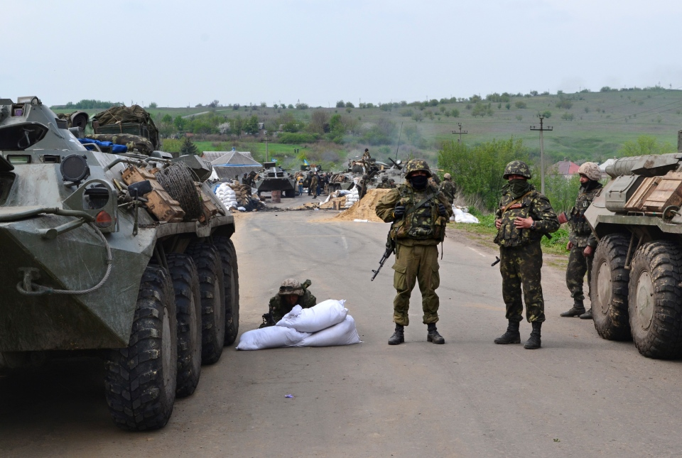 Ukrainian government troops guard a checkpoint just outside Slovyansk, eastern Ukraine, Friday, May 2, 2014. (AP / Andrei Petrov)