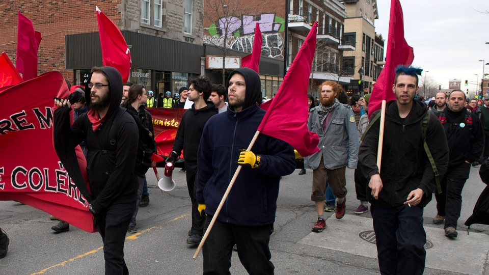 Protesters march during the annual May Day anti-capitalism demonstration Thursday, May 1, 2014 in Montreal. (THE CANADIAN PRESS / Ryan Remiorz)