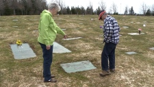 Elsie and Fred Furlong at their son's grave