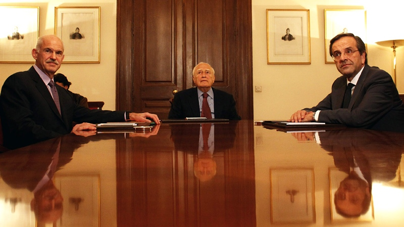 Greece's Prime Minister George Papandreou, left, Greek President Karolos Papoulias, centre and opposition leader Antonis Samaras sit at the Presidential Palace in Athens on Sunday, Nov. 6, 2011. (AP / Kostas Tsironis)
