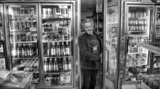 Military veteran Claude Lord purchases beer at a Montreal convenience store in this undated photo.