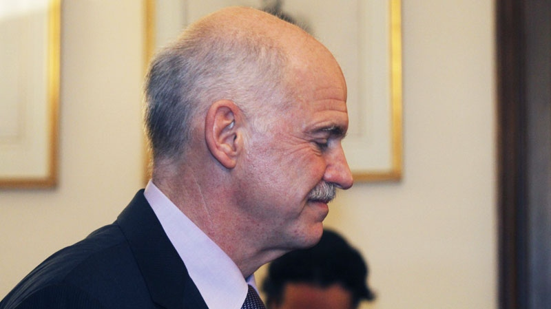 Greece's Prime Minister George Papandreou, attends a meeting at the Presidential Palace with Greek President Karolos Papoulias and opposition leader Antonis Samaras in Athens on Sunday, Nov. 6 2011. (AP / Kostas Tsironis)