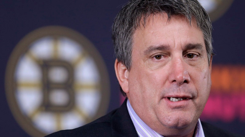 Boston Bruins president Cam Neely responds to a question from a reporter during a news conference at the TD Garden, in Boston, before a scheduled NHL team hockey practice, Sunday, Jan. 13, 2013. (AP Photo/Steven Senne)