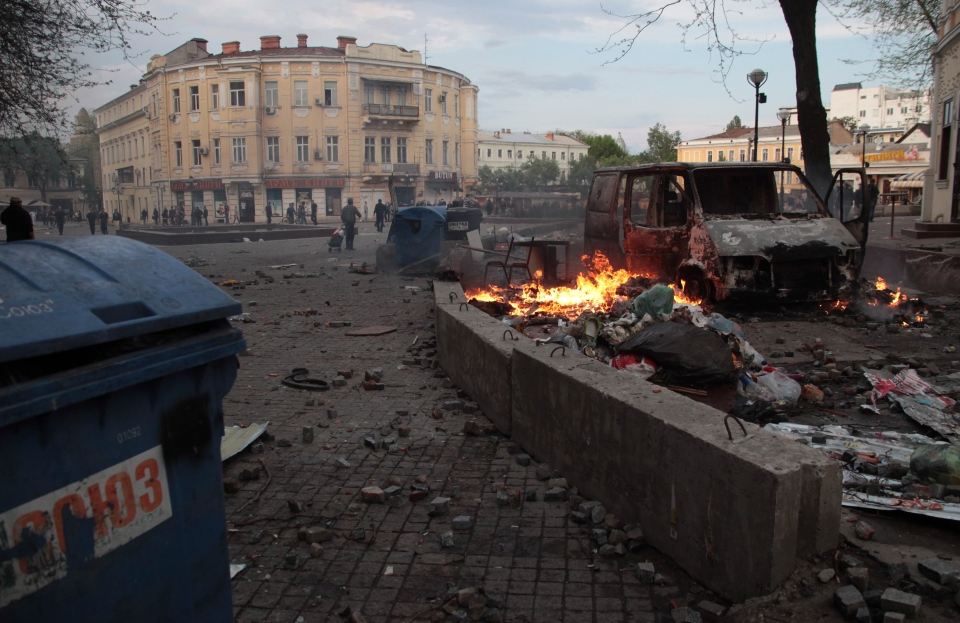 Trashed items are smoldering among debris at a square following clashes in Odessa, Ukraine, on Friday, May 2, 2014. (AP / Sergei Poliakov)