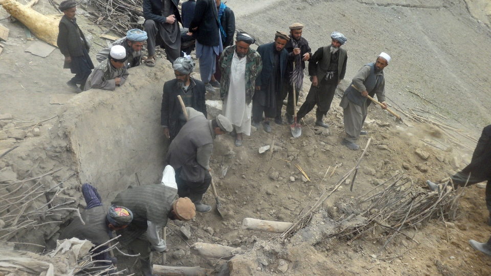 Afghans search for survivors buried after Friday's landslide in Abi-Barik village in Badakhshan province, northeastern Afghanistan, Saturday, May 3, 2014. (AP / Sayed Ibrahim)