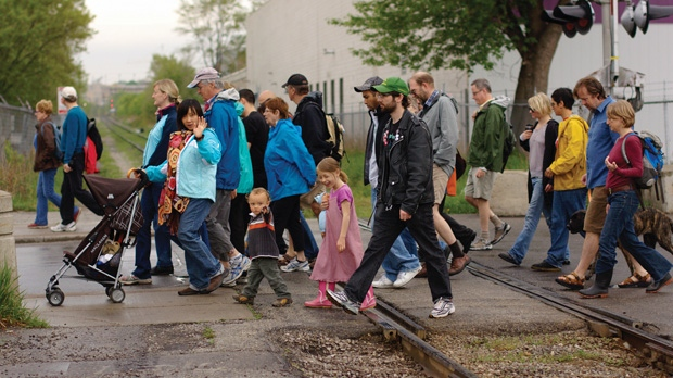 People take part in a Jane's Walk in Toronto in 2014. Due to COVID-19 the walk is going digital. (Source: Vic Gedris)
