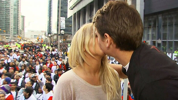 Toronto Raptors fan Matt Muszak shares a kiss with his girlfriend, Sandra Chenier, in Maple Leaf Square in Toronto on May 2, 2014.