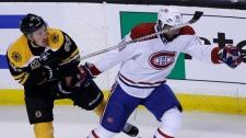 Boston Bruins left wing Brad Marchand, left, tangl