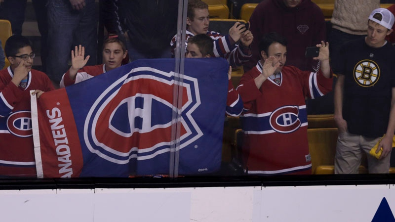 Montreal Canadiens fans watch warm ups prior to Game 2 in the second-round of the Stanley Cup hockey playoff series against the Boston Bruins in Boston, Saturday, May 3, 2014. (AP Photo/Charles Krupa)