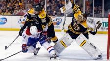 Boston Bruins defenseman Johnny Boychuk (55) check